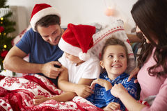 Christmas morning. Spending Christmas morning with family in the bed Royalty Free Stock Photography