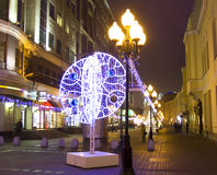 Christmas Moscow. MOSCOW - DECEMBER 29, 2013: illumination for Christmas and New Year holidays on Old Arbat street Stock Images