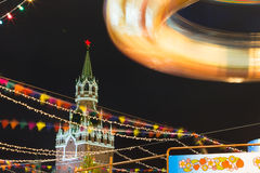 Christmas in Moscow, Russia. Christmas lighting in Moscow. Fair on the Red Square. Festivities. Christmas tree. Twisting carousel. A long exposure of a carnival royalty free stock image