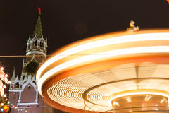 Christmas in Moscow, Russia. Christmas lighting in Moscow. Fair on the Red Square. Festivities. Christmas tree. Twisting carousel. A long exposure of a carnival stock photo