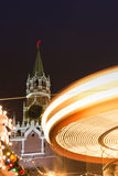 Christmas in Moscow, Russia. Christmas lighting in Moscow. Fair on the Red Square. Festivities. Christmas tree. Twisting carousel. A long exposure of a carnival royalty free stock photo