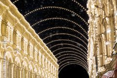 Christmas in Moscow during snowstorm. Decorated Nikolskaya street near Red Square with amazing lights decorations at night Stock Photo