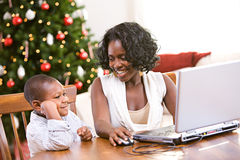 Christmas: Mother And Son Using Laptop Stock Photography