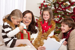 Christmas: mother with three children Royalty Free Stock Photo