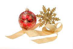 Christmas decoration motif. Christmas motif, red glitter bauble with a gold glitter star and gold ribbon isolated against white Stock Photography