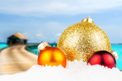 Christmas motivated front with blurred tropical island Stock Image
