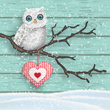 Christmas motive, cute white owl sitting on dry branch in front of blue wooden wall, illustration. Christmas motive, cute white owl sitting on dry branch in royalty free illustration