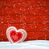 Christmas motive in scandinavian style, red and white decorated heart in front of wooden wall, illustration Stock Photos