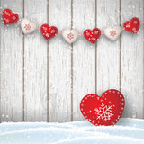 Christmas motive in scandinavian style, red and white decorated hearts in front of bright wooden wall, illustration Royalty Free Stock Images