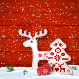 Christmas motive in scandinavian style, red and white folk decorations in front of wooden wall, illustration Stock Images