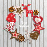 Christmas motive, small scandinavian styled decorations lying on wooden desk, illustration. Christmas background, small scandinavian styled red decorations lying stock illustration