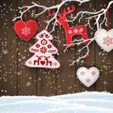 Christmas motive, various red and white decorations hanging on dry branch in front of brown wooden wall, illustration. Christmas motive, various red and white vector illustration