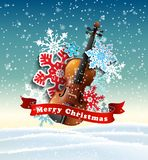 Christmas motive with violin and paper snowflakes royalty free stock image