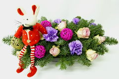 Christmas mouse on the background of the Christmas bouquet Stock Image