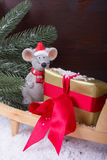 Christmas mouse with gift on wheelbarrow Royalty Free Stock Image
