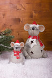 Christmas Mouse in snow on a wooden background Royalty Free Stock Image
