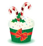 Christmas muffin with candy canes Royalty Free Stock Photo