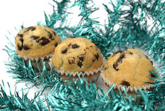 Christmas muffins. Muffins surrounded by christmas ornament Stock Images