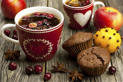 Christmas mug with chocolate muffins Stock Images
