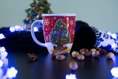 Christmas Tree Mug on a Table with Decorations. Christmas Mug with Christmas Decorations Royalty Free Stock Photography