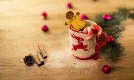 Christmas mug with Christmas decorations and cookies Stock Image