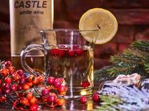 Christmas mug decoration lemon slice on bottle wine background. Royalty Free Stock Photo