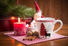Christmas mug with  decorations. Christmas mug with Christmas decorations on wooden background Stock Photography