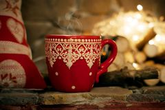 Christmas. mug. fireplace. Royalty Free Stock Images