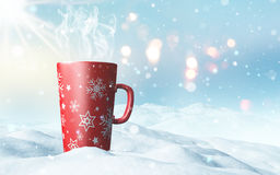 Christmas mug nestled in snow Royalty Free Stock Image