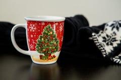 Christmas Mug with Scarf on a Table. Christmas Drink and a Scarf on a Table Stock Photos