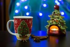 Christmas Mug with Christmas Tree Candle. Christmas Mug on a table with Christmas Tree Candle Stock Images