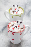 Christmas mugs hot chocolate with melted marshmallow reindeers Royalty Free Stock Image
