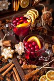 Mulled wine with slice of orange and spices stock photos