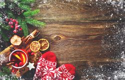 Christmas mulled red wine with spices and fruits on a wooden rus stock photography