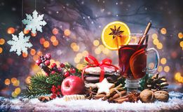 Christmas mulled red wine with spices and fruits on a wooden rus stock image