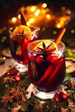 Christmas mulled red wine with spices and fruits on a wooden rus stock photos