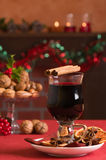 Christmas Mulled Wine. Mulled red wine at Christmas with selection of nuts in background Royalty Free Stock Photography