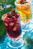 Christmas mulled wine and apple cider on a blue background Royalty Free Stock Image