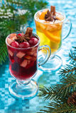 Christmas mulled wine and apple cider on a blue background. Vertical, top view Stock Photos