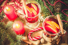 Christmas Mulled Wine, Candles and Spices. Vintage Toned Royalty Free Stock Photography