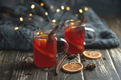 Christmas mulled wine. Punch holiday composition beverage table hot ambiance seasonal fruit bright winter twinkle orange wooden sweet aroma clove food homemade stock image