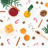 Christmas mulled wine with cinnamon, anise and candy cane on white background. Flat lay, top view Stock Photo