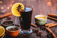 Christmas mulled wine with cinnamon, anise stars, honey and orange slices on wooden background Royalty Free Stock Image