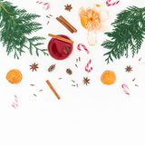 Christmas mulled wine with cinnamon, citrus and candy cane on white background. Flat lay, top view Stock Photos