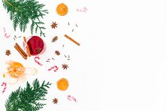 Christmas mulled wine with cinnamon, citrus and candy canes on white background. Flat lay, top view Stock Photos