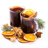 Christmas mulled wine with cinnamon and orange slices Stock Photos