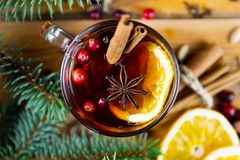 Christmas mulled wine with cinnamon, spices and orange slices on stock photo