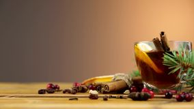 Christmas mulled wine with cinnamon, spices and orange slices on a wooden background. Winter hot drink stock footage