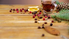Christmas mulled wine with cinnamon, spices and orange slices on a wooden background. Winter hot drink stock video