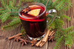 Christmas mulled wine in cup on wooden background Stock Photo